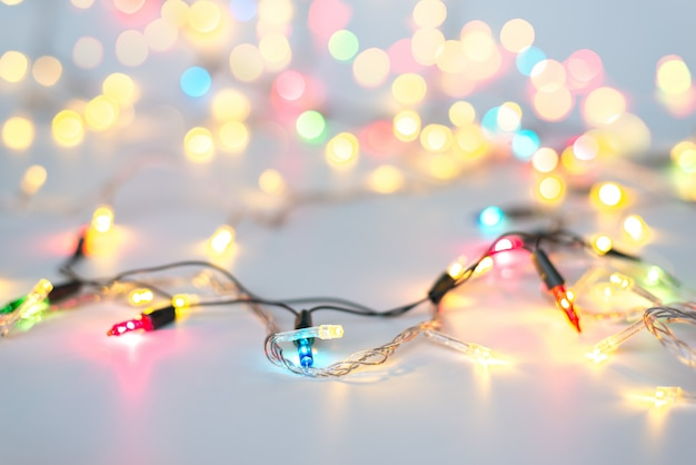 Christmas lights on string in multi colours; blue, yellow, green, pink