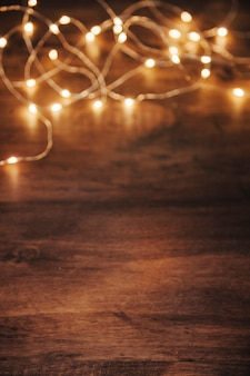 Christmas lights on wooden surface