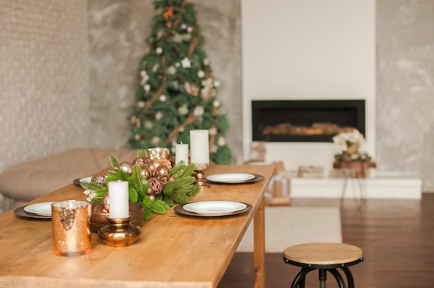 Christmas living room decor and copy space. rustic living room with a table set for christmas
