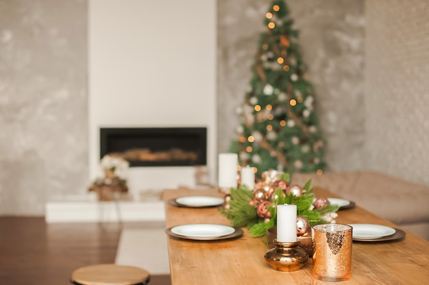 Christmas living room decor and copy space. rustic living room with a table set for christmas.