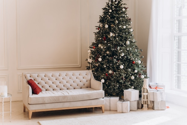 Christmas living room interior with vintage sofa and christmas tree