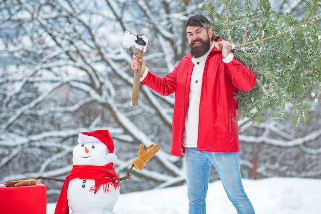 Christmas lumberjack with axe and christmas tree.