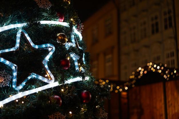 Christmas luminous neon star on the christmas tree