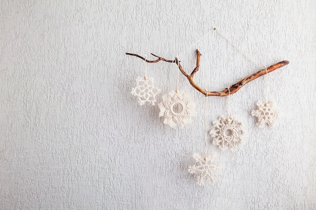 Christmas macrame snowflakes  decor for home and cafe winter and new year holidayscopy space