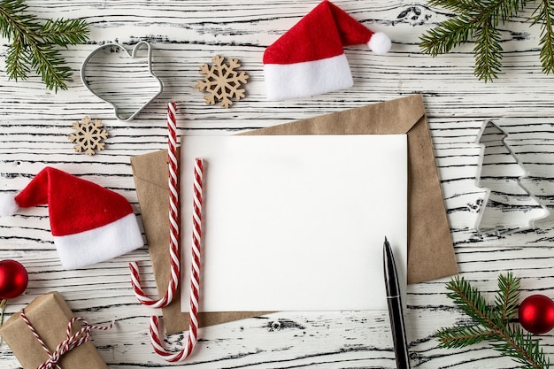 Christmas mail, envelopes with letters on a light wooden table.