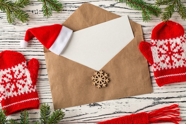 Christmas mail, envelopes with letters on a light wooden table