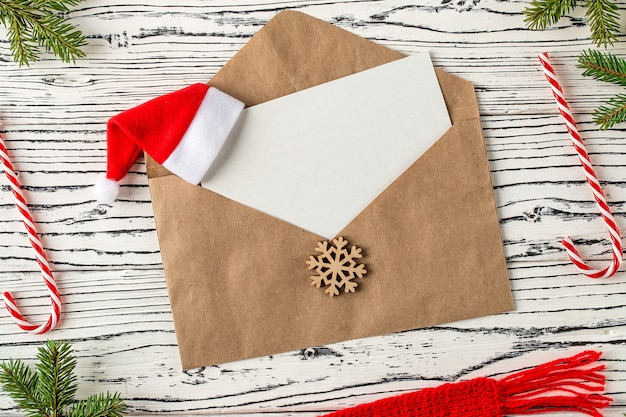 Christmas mail, envelopes with letters on wooden table.