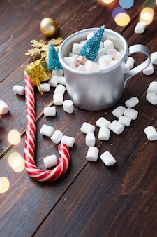 Christmas marshmallows and new year decorations on wood table. winter holidays, new year mood