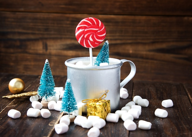 Christmas marshmallows and new year decorations on wood. winter holidays, new year mood