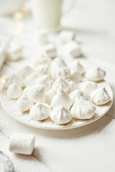 Christmas meringue with marshmallows by the window