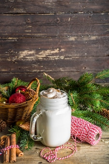 Christmas milkshake on grass jar