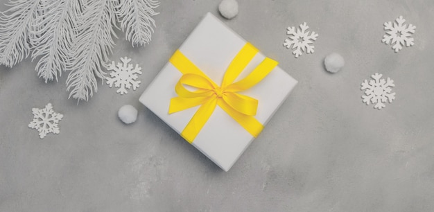 Christmas mock up banner background with snowflakes and gift boxes on wooden background with place for text.