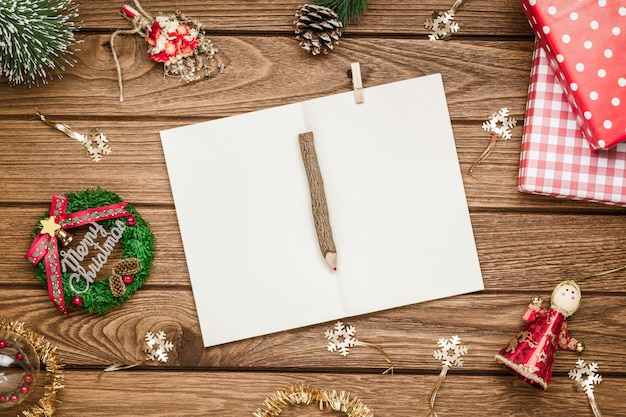 Christmas mockup blank notebook on grunge wood
