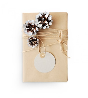 Christmas mockup gift box wrapped in brown recycled paper