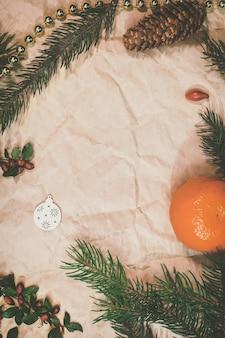 Christmas mockup for postcard with dry fruits, craft paper, gift box, handmade christmas toys