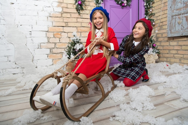 Christmas mood. happy new year. winter. christmas tree and presents. xmas online shopping. family holiday. the morning before xmas. little girls on sleigh. child enjoy the holiday.