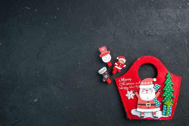 Christmas mood with decoration accessories and new year gift box on dark surface