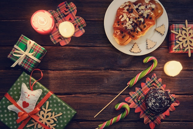 Christmas morning table with croissant, sweets and gifts