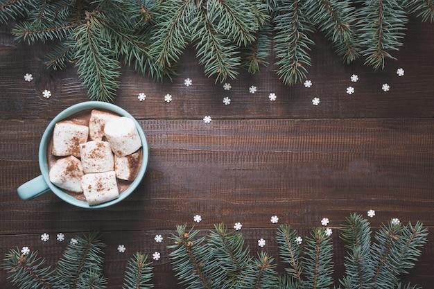 Christmas mug of coffee with marshmallow on dark background