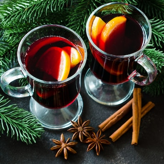 Christmas mulled red wine with spices on dark background