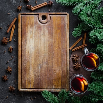 Christmas mulled red wine with spices on dark