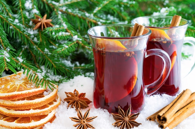 Christmas mulled red wine with spices and oranges.