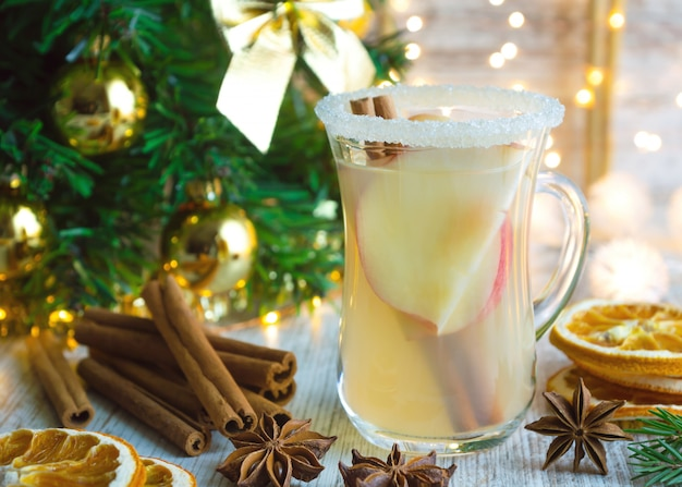 Christmas mulled white wine with spices and apples.