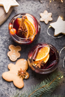 Christmas mulled wine  in circle glasses delicious holiday like parties with cinnamon star anise spices. traditional hot drink in circle glasses or beverage, festive cocktail at x-mas or new year