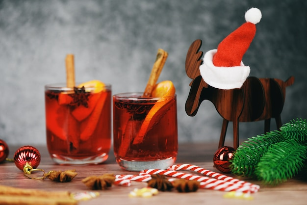 Christmas mulled wine delicious holiday like parties with orange cinnamon star anise spices for traditional christmas drinks winter holidays red mulled wine glasses reindeer decorated