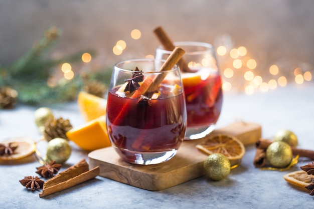 Christmas mulled wine delicious holiday like parties with orange cinnamon star anise spices. traditional hot drink or beverage, festive cocktail at x-mas or new year