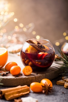 Christmas mulled wine delicious holiday like parties with orange cinnamon star anise spices. traditional hot drink in circle glasses or beverage, festive cocktail at x-mas or new year