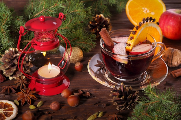 Christmas mulled wine and ingredients on a wooden table
