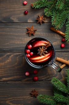 Christmas mulled wine with apple and cranberries. holiday concept.