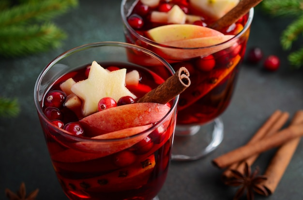 Christmas mulled wine with apple, orange and cranberries. holiday concept.