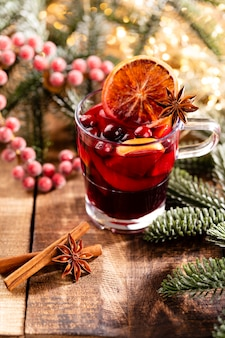Christmas mulled wine with spices on a wooden rustic table