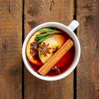 Christmas mulled wine on a wooden table. traditional hot drink, top view