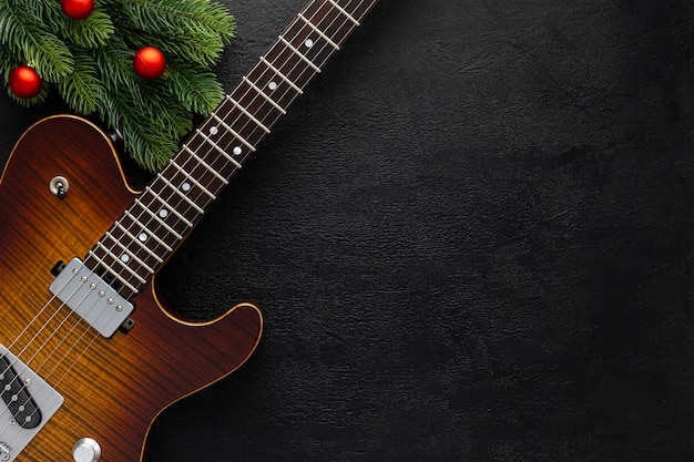 Christmas music composition with guitar and fir tree branches