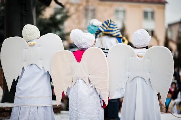 Christmas nativity scene parade of children on winter day.