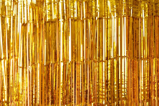 Christmas, new year background and texture of gold tinsel or shiny ribbons