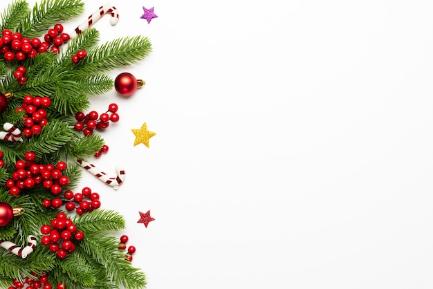 Christmas and new year background, top view of spruce branches, pine cones, red berries