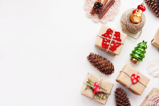 Christmas and new year background with handmade presents wrapped in craft paper and decorations.