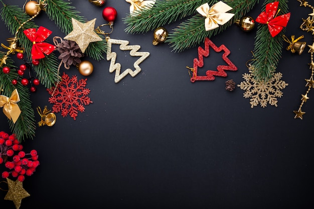 Christmas and new year black background with red and golden decorations