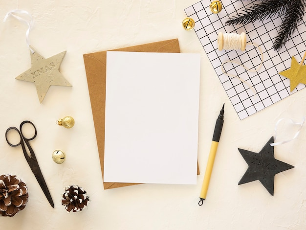 Christmas or new year black and golden mockup copy space on a paper sheet with christmas decorations