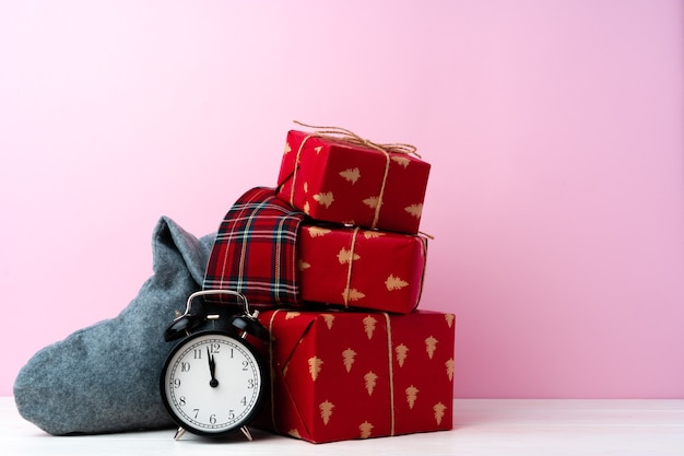 Christmas and new year celebration countdown concept with alarm clock