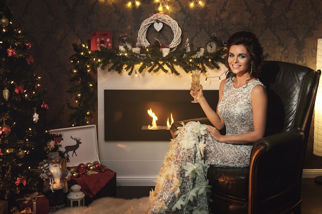 Christmas or new year celebration. happy woman with a glass of champagne.