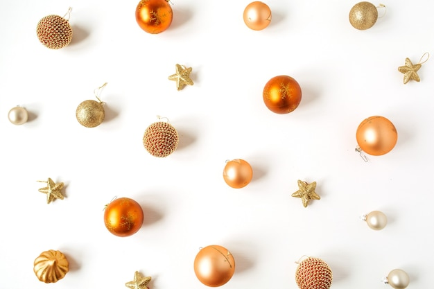 Christmas new year composition. colorful christmas baubles balls and stars pattern on white