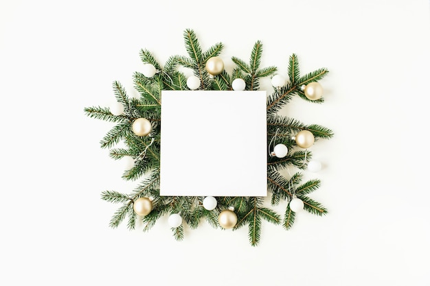 Christmas new year composition. square mock up frame with blank copy space, fir branches, christmas balls on white