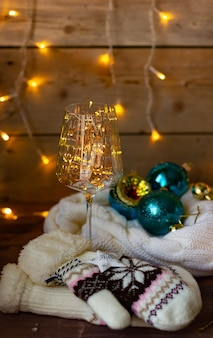Christmas new year composition with candles, garlands and christmas balls, new year still life