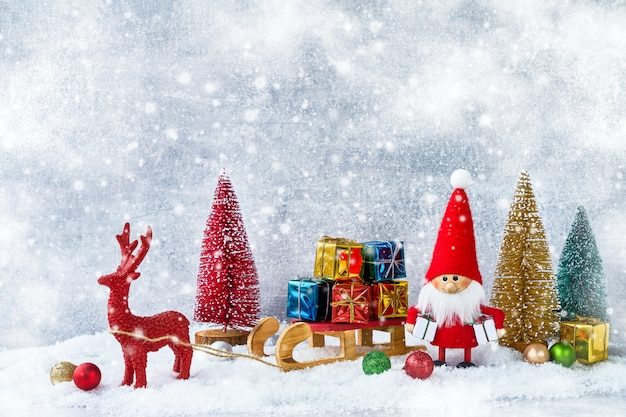 Christmas or new year composition with santa claus figure, gifts, christmas decoration. co