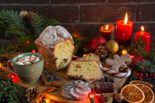 Christmas and new year compositions on a brown background christmas cake gingerbread cacao